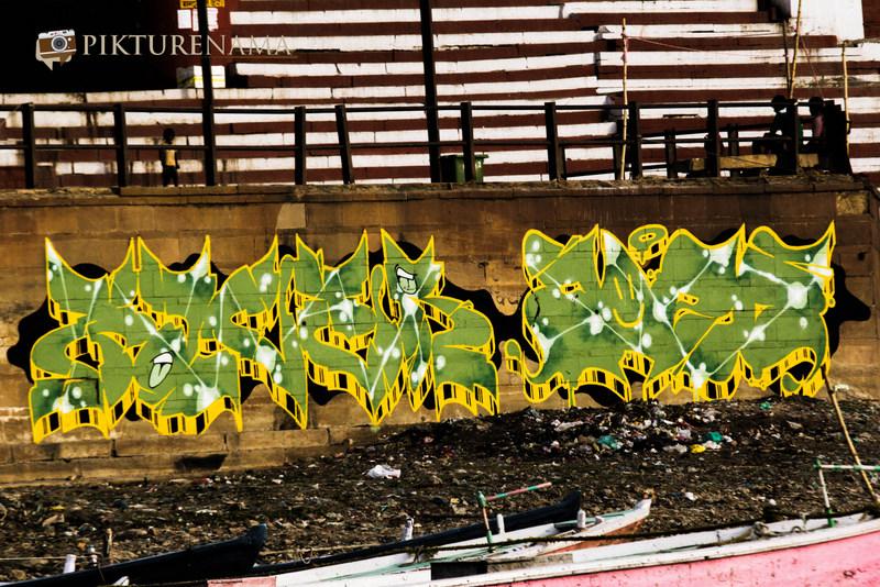 Graffiti on Varanasi Ghats green and yellow
