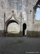 Tomh niche in north wall of church at Askeaton Friary. The door leading to the sacristry.