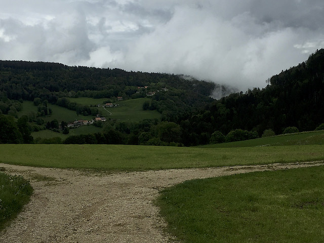 High in the Jura, Swiss countryside opens up.