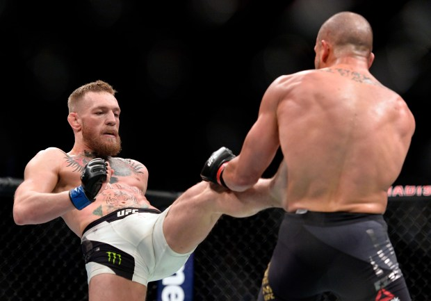 NEW YORK, NY - NOVEMBER 12: (L-R) Conor McGregor of Ireland kicks Eddie Alvarez in their UFC lightweight championship fight during the UFC 205 event at Madison Square Garden on November 12, 2016 in New York City. (Photo by Brandon Magnus/Zuffa LLC/Zuffa LLC via Getty Images)