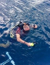 Randy putting those scuba lessons to work, diving the boat in Bequia
