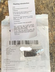 packet of seeds, mail envelope, and planting instructions