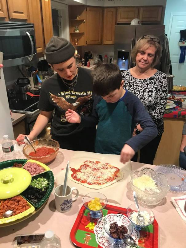 "My cousins and aunt are pictured here at one of our ""Make Your Own Pizza and Ice Cream Sundae"" parties over the winter holiday!"