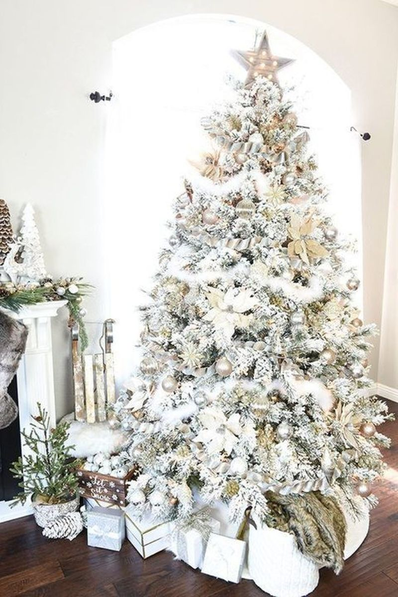 Stunning White Christmas Tree Ideas To Decorate Your Interior 25
