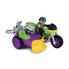 Véhicule + Figurine 6 cm Tortues Ninja - Donatello Véhicule avec son et un personnage de 6 cm.Chaque véhicule a une fonction et un son propre Véhicule adapté pour les jeunes enfants.