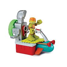 Véhicule + Figurine 6 cm Tortues Ninja - Michelangelo Véhicule avec son et un personnage de 6 cm.Chaque véhicule a une fonction et un son propre Véhicule adapté pour les jeunes enfants.