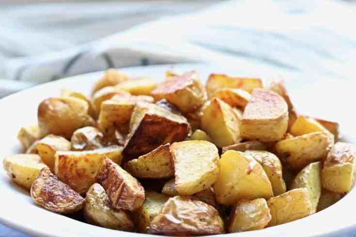 Perfectly roasted potatoes!  Super crispy, low fat, easy side dish and kid-friendly.  This recipe only has 3 ingredients and takes 25 minutes to make!!!!