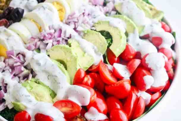 Close up of very veggie cobb salad with dressing