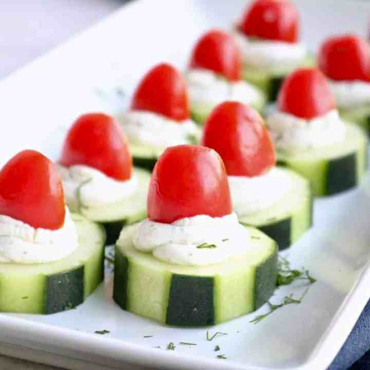 Platter of healthy cucumber goat cheese bites