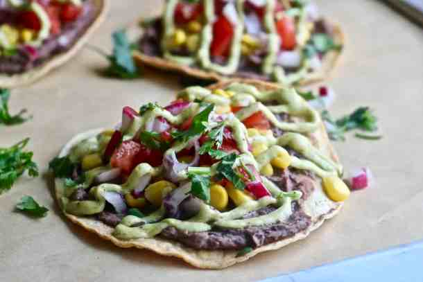 Black Bean and Veggie Loaded Tostadas with Avocado Cream