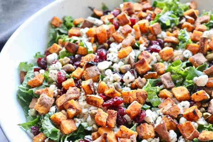 Simple winter kale salad with sweet potato croutons. Hearty kale, crunchy pistachios, tart dried cranberries, brown rice, goat cheese and amazing sweet potato croutons. Topped with a delicious mustard vinaigrettes dressing. Vegetarian, gluten-free and so DELICIOUS! #simple salad #kale #winter salad #vegetarian #sweet potatoes