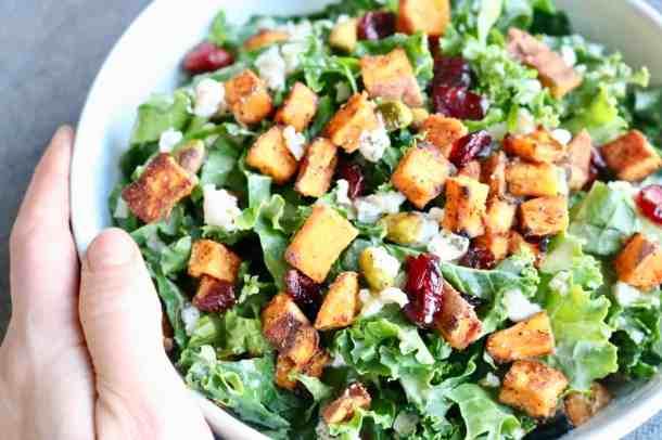 Holding bowl of kale salad