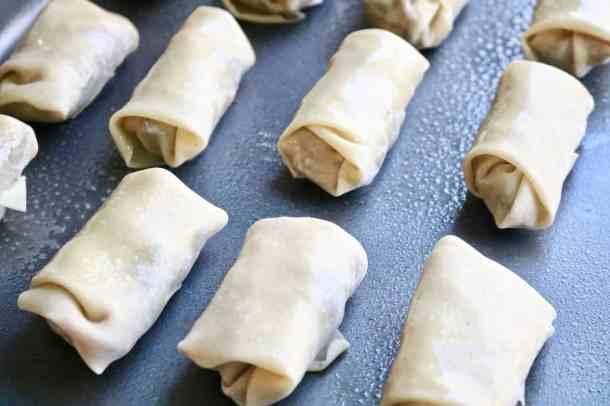 Tofu veggie egg rolls on a baking sheet