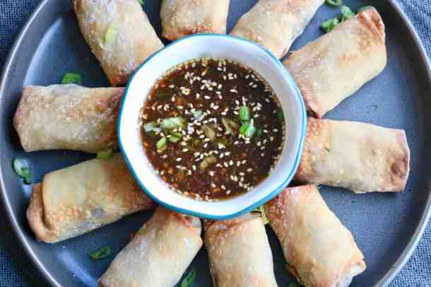 Egg rolls with dipping sauce on plate