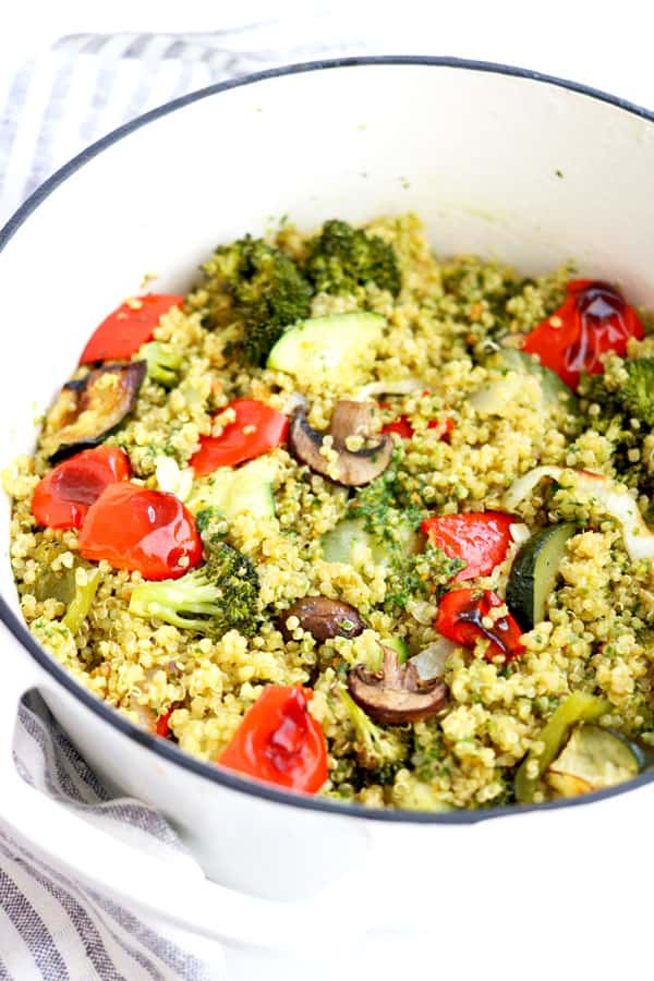 Fluffy quinoa, herby lemony basil pesto and perfectly roasted veggies all mixed together to form this hearty, satisfying and delicious recipe that is gluten-free, vegetarian and comes together in 30 minutes or less!