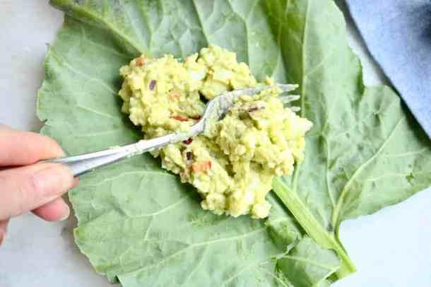 Making avocado egg salad wraps
