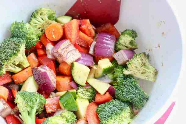 Tossing veggies in a bowl