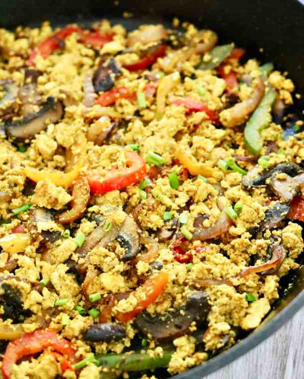 Tofu scrambles with veggies in a pan