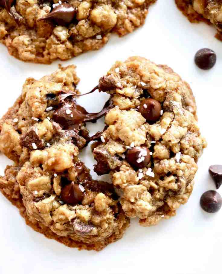 These easy oatmeal chocolate chip cookies are a healthier yet still crazy delicious version of your favorite classic cookies. Less refined sugar and flour with a hint of cinnamon and walnuts. You can even make them gluten free! This simple cookie recipe is one you have to try! #healthycookierecipes #oatmealcookies #chocolatechipcookies #easycookierecipes