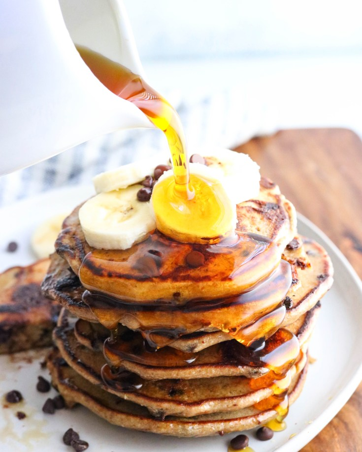 Healthy Banana Oatmeal Pancakes:  Oats, bananas, eggs, cinnamon and vanilla blended perfectly and then poured onto a hot skillet.  Pancake heaven! Soft and fluffy, full of fiber, protein and vitamins, comes together in minutes. Paired perfectly with fruit and warm maple syrup. Lower in carbs and calories and super easy to make!!!! #skinnybananapanckaes, #bananas, #oats, #oatmeal, #fluffypancakes, #Easybreakfastrecipe