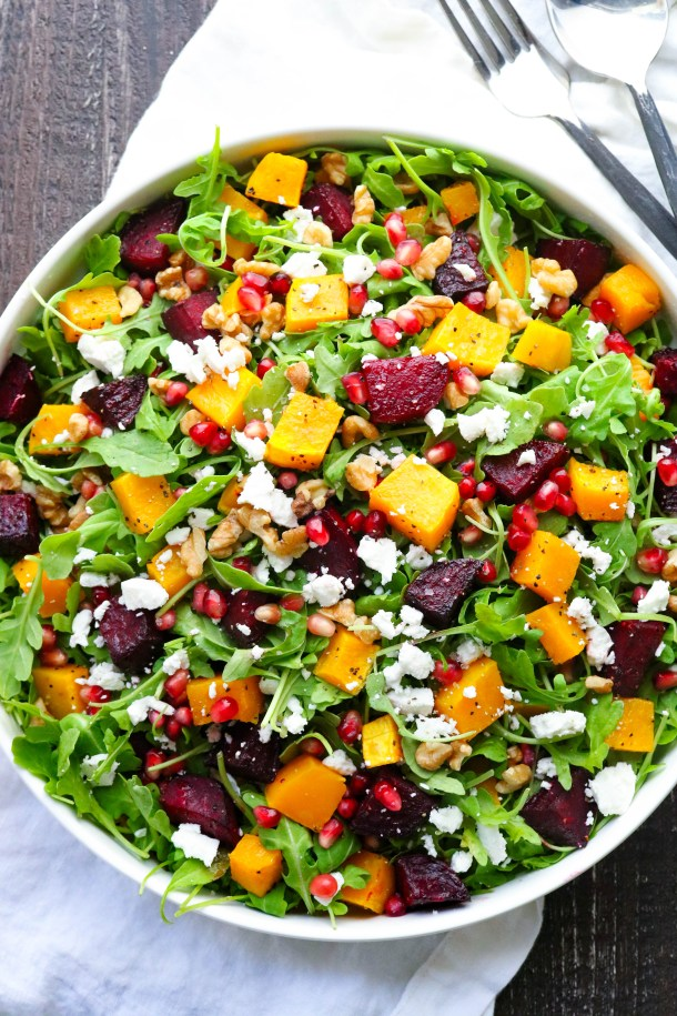 Salad with roasted beets and butternut squash with nuts and pomegranate seeds.