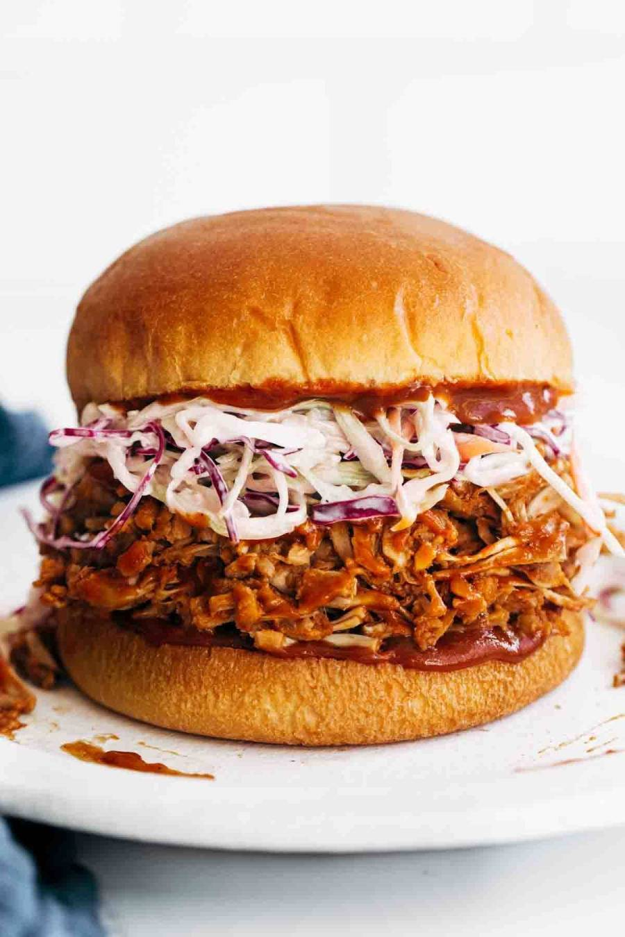Close-up of BBQ Jackfruit Sandwiches with slaw on a bun.