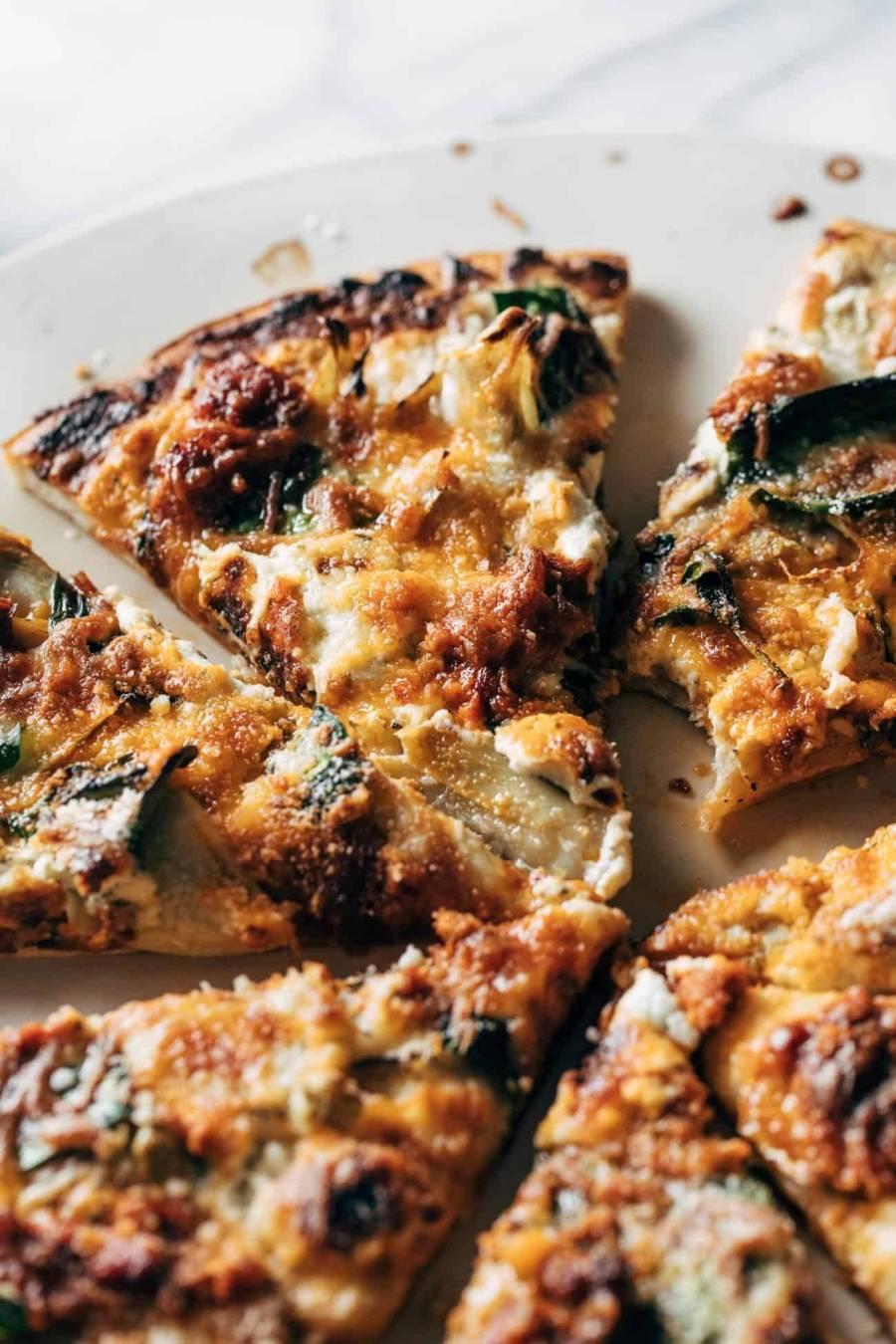 Spinach and artichoke pizza slices