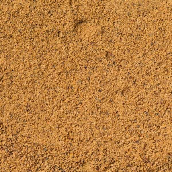 ground nutmeg powder close up granules