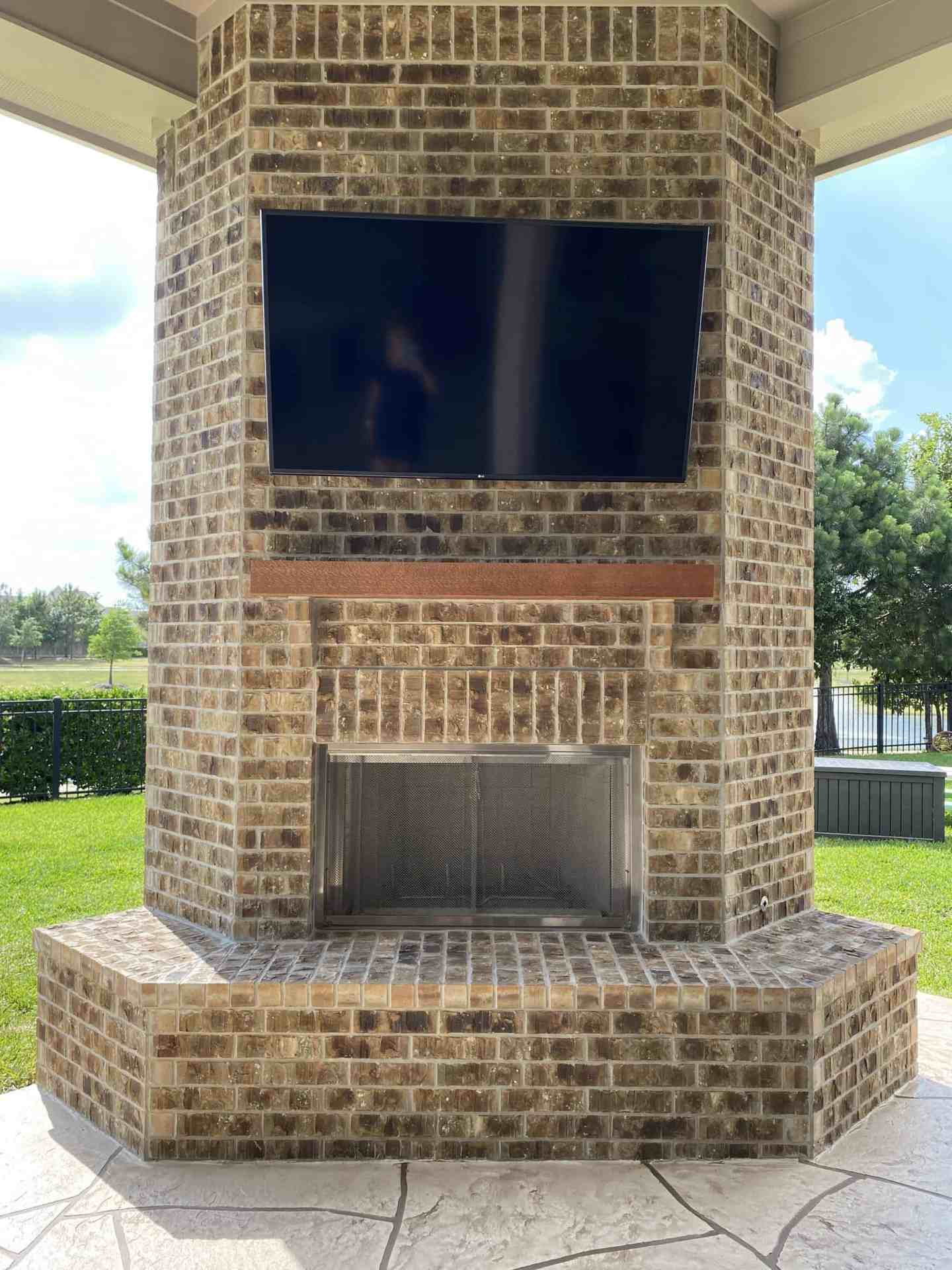 Back-Patio-Extension-Matts-Custom-Decks-fireplace-tv-mount
