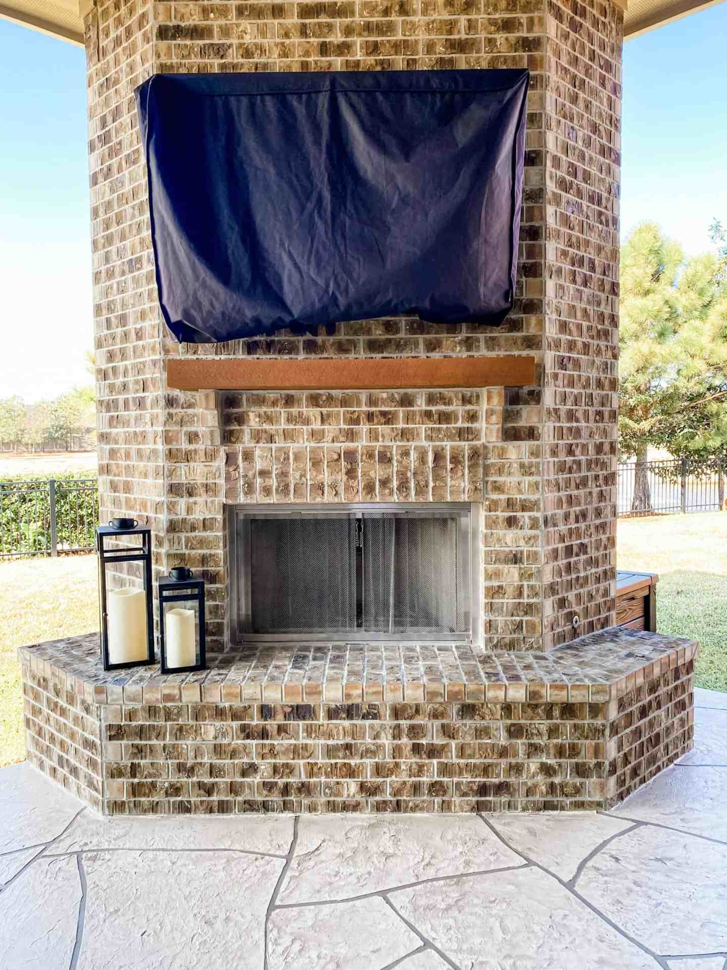 outdoor-black-lanterns-with-outdoor-pillar-candles-for-outdoor-fireplace