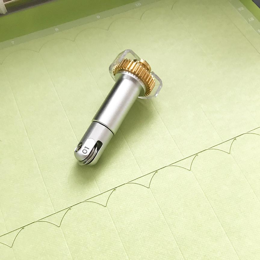 Cricut Scoring Wheel on Green Cricut Cardstock