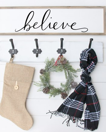 Download a FREE Believe Christmas SVG File by Pineapple Paper Co. - Believe Wood Sign hanging above hooks with stocking and scarf