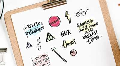 Free Harry Potter Printable Stickers on Clipboard for Planners & Crafts by Pineapple Paper Co.