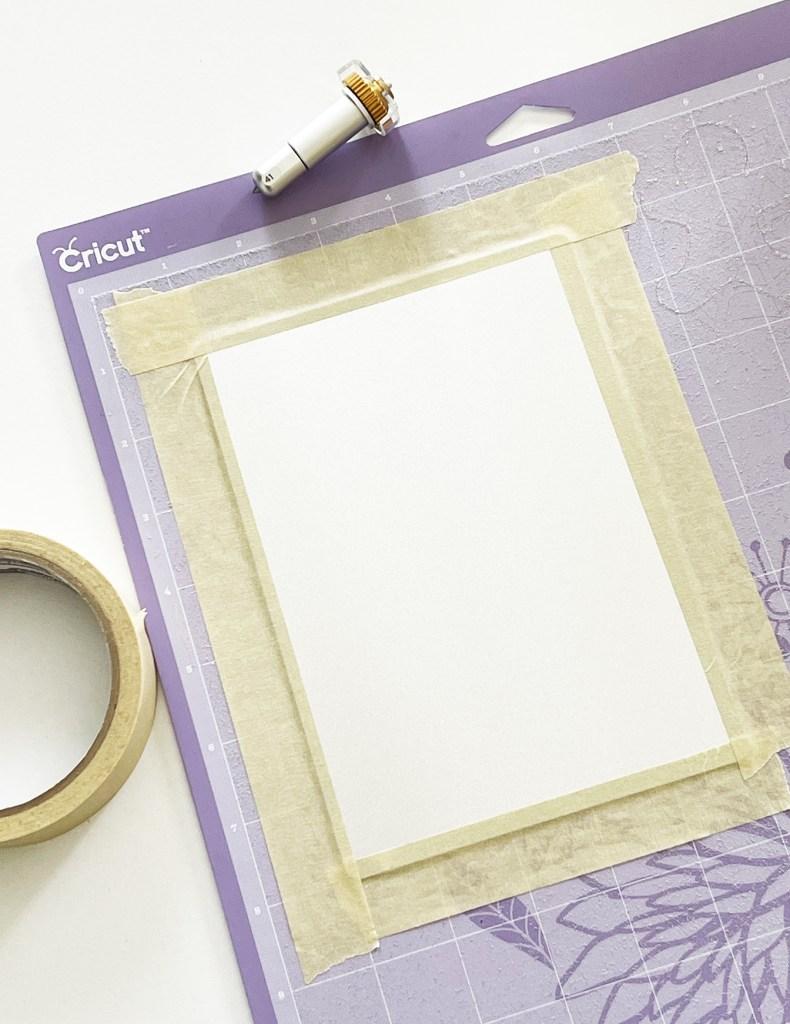 Cricut Engraving Aluminum Sheet taped onto Cricut StrongGrip Mat with Masking Tape