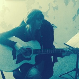 Liz Mills playing and singing at the studio.
