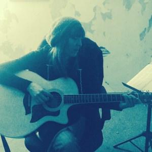 Liz Mills playing and singing at the studio.