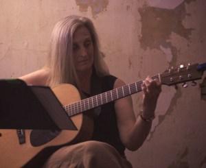 Barbara Reese playing guitar