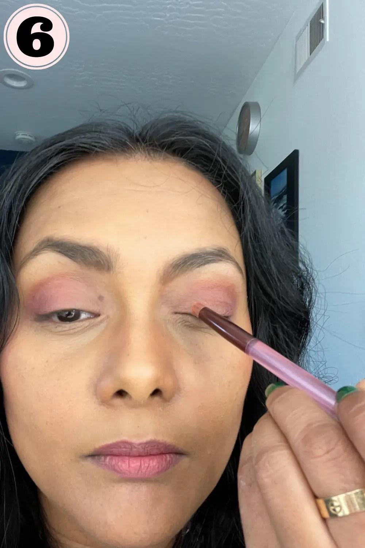 Applying lighter eyeshadow to my inner corner of eye lid