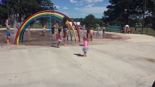 Having fun at the splash park