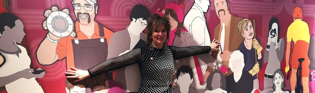 Cat James in front of her specially designed wallpaper