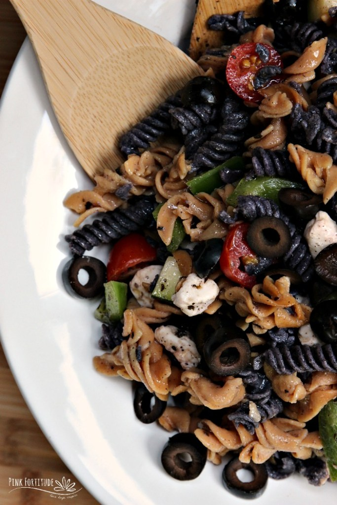 Sometimes, you need something quick and easy to whip up for your Halloween party. This Italian-style Halloween pasta salad is THE perfect dish to feed a crowd. Oh and BTW - it's made with whole foods and is gluten free and dairy free to accommodate anyone's nutritional protocols or dietary needs. AND - the black and purple pasta is made with all-natural ingredients. As in - real food. You don't have to be scared with this recipe...