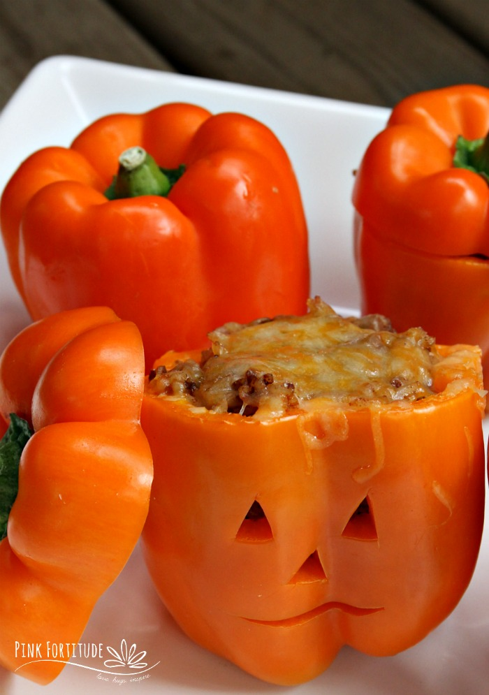 Orange peppers are screaming for Halloween. Why not try this Halloween Taco Stuffed Peppers recipe? They are just as easy to make as tacos, taste just as good (if not better) and are super cute little Jack O' Lantern pumpkins for your Halloween dinner or Halloween party. They are gluten free and you can even make them dairy free too. Get the recipe... #halloween #recipe #taco #pinkfortitude