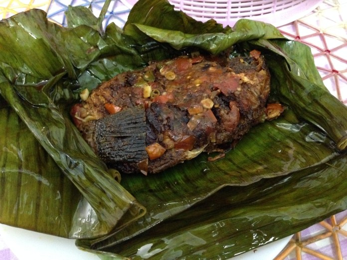 Kerala Cuisine: Karimeen Pollichathu made using banana leaves