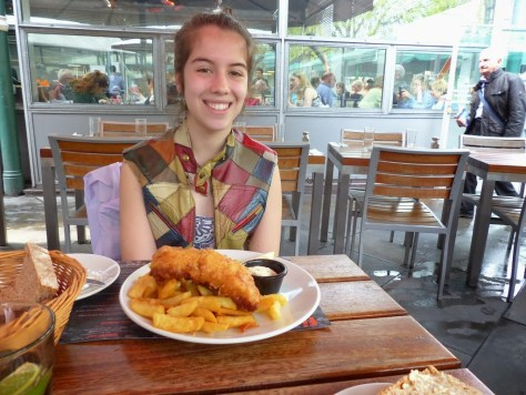 Chloe enjoying her first fish 'n chips dish