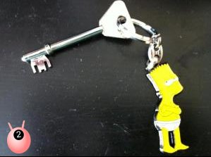 Bart SImpson wearing just pants as a keyring with silver front door key