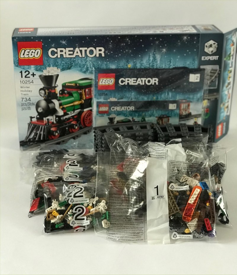 The contents of the LEGO Creator Winter Wonderland Train Set