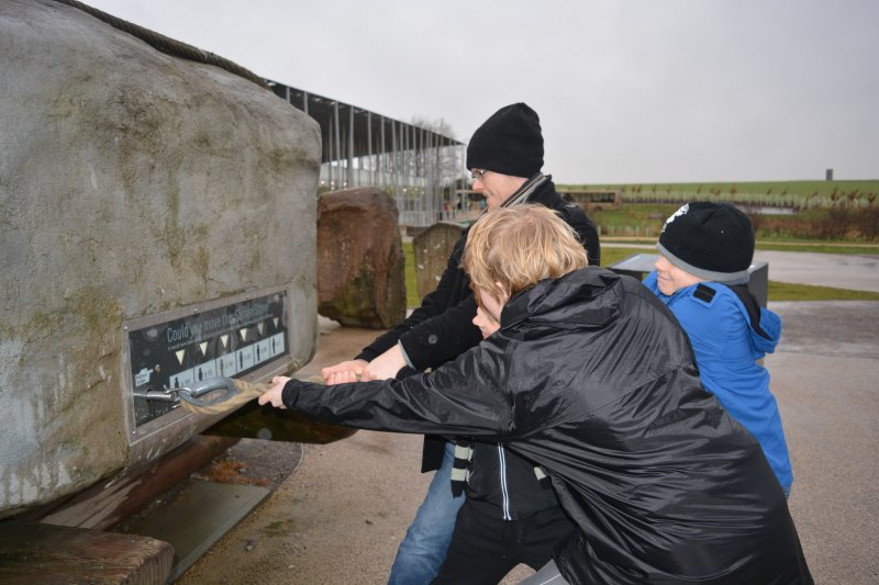 family pulling the sarsen builder at stonehenge