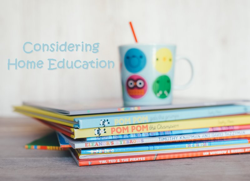 Books and cup with straw