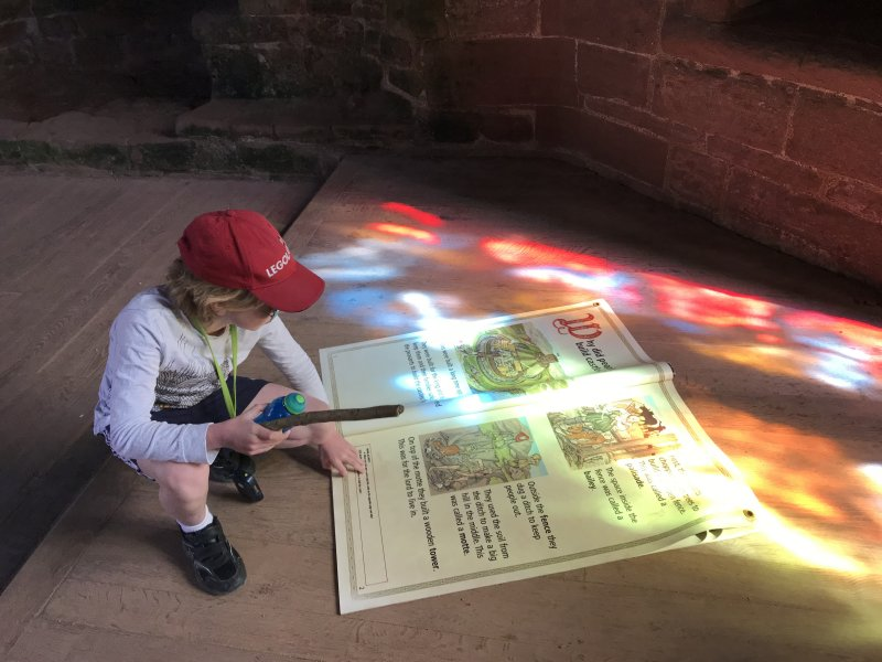 stain glass light over child reading book