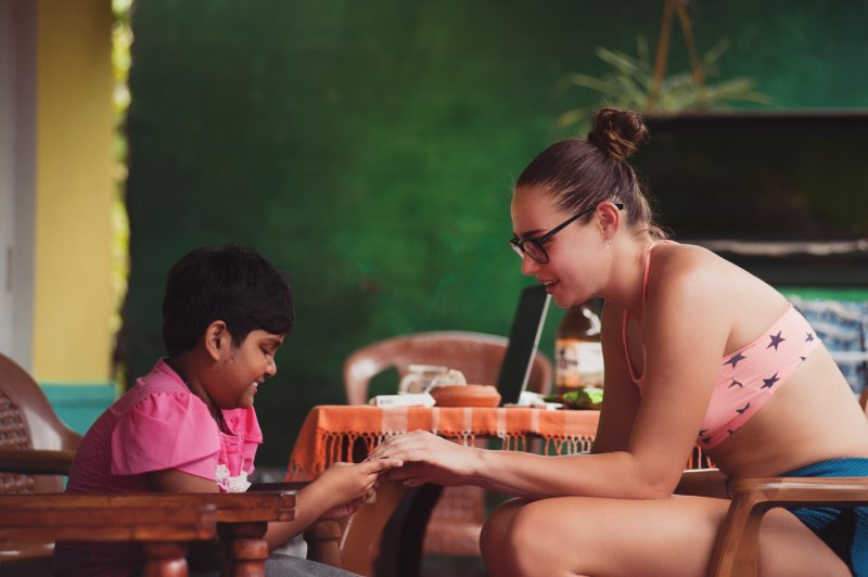 woman working with child